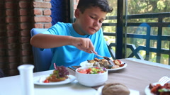 Child Eating Lunch In A Restaurant 2 Stock Footage