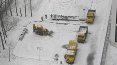 Workers digging a ditch to lay a cable on a winter day Stock Footage