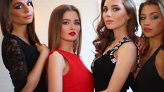 Four beautiful, slender girls in dresses and high heels Stock Footage