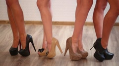 Four pairs of shapely female legs in high-heeled shoes Stock Footage