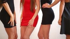 The four slender young woman in short dresses dancing Stock Footage