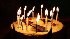 Person blows out the candles on a birthday cake in the dark Stock Footage
