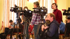 Reporters shoot press conference in Institute of Neurosurgery Stock Footage