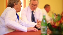 Doctors exchange words at press conference in Institute of Neurosurgery Stock Footage