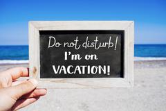 text do not disturb I am on vacation - stock photo