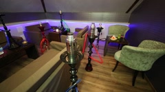 Bright cozy hall with hookah, tables and armchairs Stock Footage