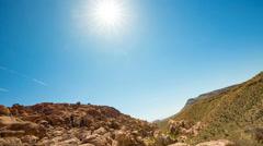 Sun Flare Pan Mountain to Large Boulder Stock Footage