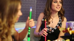 Young girl resting with her friend and smoking hookah Stock Footage