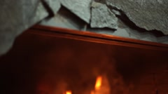 A bright fire in the fireplace. A warm light. A fireplace in a dark room. Beauti - stock footage