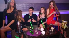 Five young people having fun and smoking hookah together Stock Footage
