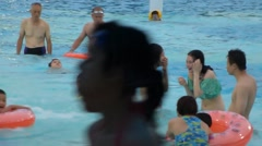 People are swimming in the swimming pool at the Baoan stadium in Shenzhen Stock Footage