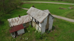 Aerial of Old Abandoned House in Rural Area Stock Footage