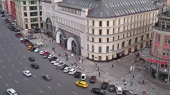 People and cars on a spacious street, top view Stock Footage