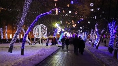 People walk on Chistoprudny boulevard in the New Year time Stock Footage