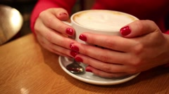 Female hands hold and raise a large cup of coffee in a cafe Stock Footage