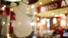 Snowman painted with white paint on the mirror in a cafe Stock Footage