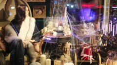 A shop window with mannequin, candles and paintings Stock Footage