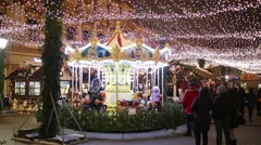 Christmas decoration and merry-go-round under the garlands ceiling Stock Footage