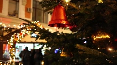 Red bell and Christmas decorations with a flashing garland Stock Footage