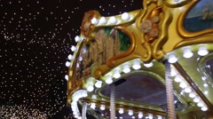 Carousel against the backdrop of garlands closeup Stock Footage