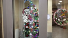 The image of Santa Claus and bell on the glass door Stock Footage