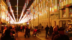 Bolshaya Dmitrovka Street with Christmas decorations filled with people Stock Footage