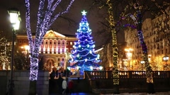 Trees decorated with garlands on Tverskaya Square Stock Footage