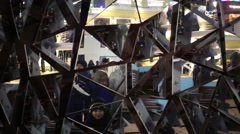Triangular pieces of mirror move, the crowd of people is reflected Stock Footage