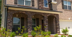 Brick Home Exterior Tilt Down Close Up Stock Footage