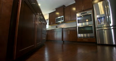 Kitchen Low Angle Reveal Appliances and Cabinets Stock Footage