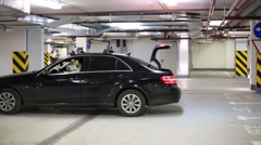 The driver puts the car into a parking lot on the indoor parking Arkistovideo