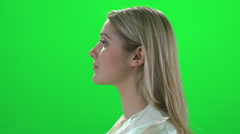 Blond women profile portrait isolated  green screen Stock Footage