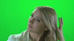 Touching blond hair women isolated green screen Stock Footage