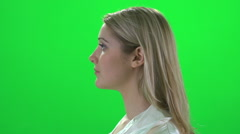 blond women side profile turning around green screen - stock footage