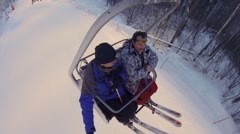 Man makes selfie with friend on cableway in ski resort, top view Stock Footage