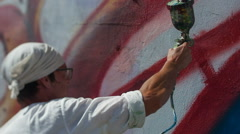 Artist paints on the wall Stock Footage