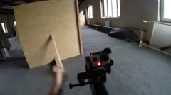 Gun in hands with camera at lasertag game in abandoned building Stock Footage