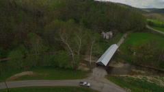 Aerial of Covered Bridge Over Creek in Rural Area Stock Footage