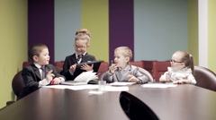 Small children at meeting in office.static shot Stock Footage