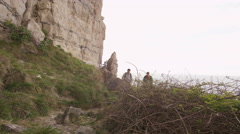 4K Male rock climbers hiking to location to begin a climb Stock Footage