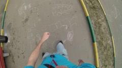 Roller skater man rides on asphalt path, selfie, top view Stock Footage