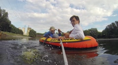 Man makes selfie and boy rowing on inflatable boat Arkistovideo