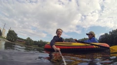 Happy woman makes selfie and boy rowing on inflatable boat Arkistovideo
