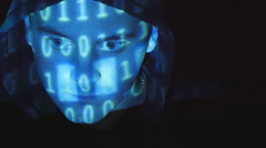 Close up shot of male face of hacker with binary code projections. - stock footage