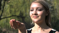 Woman outdoors leaves falling in her hand shot in slow motion 1080 Stock Footage