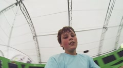 Boy teenager jumps in trampoline center and makes selfie Stock Footage