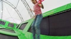 Child jumps on trampoline in center Just Jump in park Sokolniki Stock Footage