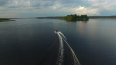 Small powerboat moving quickly on the river. Aerial view. Stock Footage