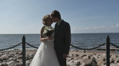 The couple on the beach after the wedding, romantic bride and groom Stock Footage