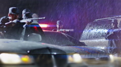 4K Police surrounding on the rain. Police attack. Armed policemen take aim. Stock Footage
